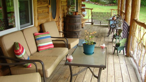 iReporter Paul Tamasi says he enjoys roughly three hours each day on his rustic front porch in Belvidere, Vermont. It's part of the massive renovation he conducted on his home, turning it into a log cabin with a grand entrance.