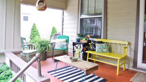 Farm Fresh Therapy blogger and iReporter Chelsea Mohrman made deliberate use of her limited budget and love of all things vintage when decorating her front porch in Clintonville, Ohio. Most of the pieces were found in antique shops, garage sales and thrift stores, but the coffee table was made by hand out of reclaimed barn wood.