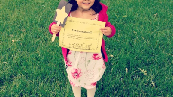 """Jesse Martinez says his daughter Isabella's graduation from Lindemann Elementary in Allen Park, Michigan, was """"very laid back."""" The children romped around in the park, sang songs for the attending parents and received certificates for completion of preschool."""
