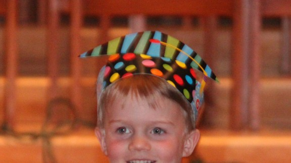 """Jill Elfering said her son Mac's graduation from Blessed Trinity Catholic Preschool in Minneapolis was a """"precious yet simple"""" sendoff to kindergarten. The kids processed in with their paper graduation hats, and their teacher talked about the year and the students' accomplishments, highlighting their three main themes: """"I'll try,"""" I'll do my best"""" and """"I'm washable.""""  After the ceremony, there was a small reception with lemonade and Rice Krispie bars."""