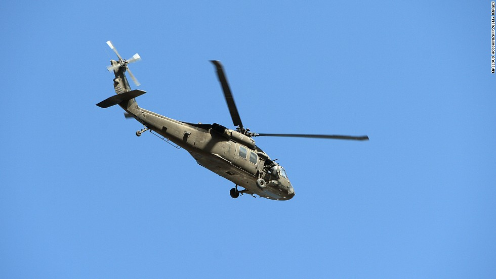 A U.S. military helicopter flies over the Kabul airport as fighting ensues between Afghan security forces and insurgents on June 10.