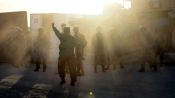Afghan police take position near the Kabul airport on June 10.