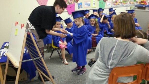 """Jean-Paul Yoko attended a preschool graduation for his girlfriend's daughter Adiena at Ecole Guyot in Manitoba, Canada, where each child received a graduation certificate and contributed snacks and juice to the reception. He says a preschool ceremony """"gives some sort of closure to the teachers who have worked so hard with these kids throughout the year."""""""