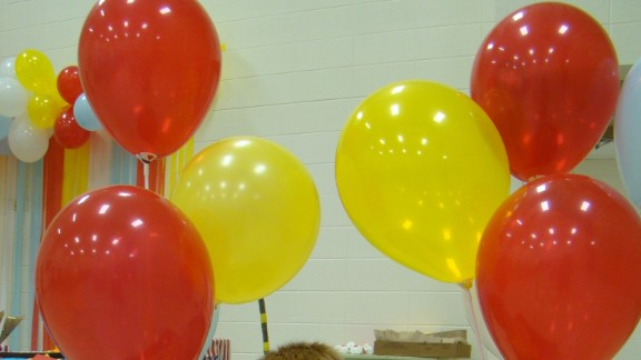 """Pleasant Hope Elementary School in Missouri put on a graduation ceremony and party inspired by the Dr. Seuss book """"Oh, the Places You'll Go!"""" (popular among graduates of all ages). Kim Jarman, mom of Riley, along with a few other homeroom parents, made truffula trees and a replica hot air balloon in which the children posed for pictures."""
