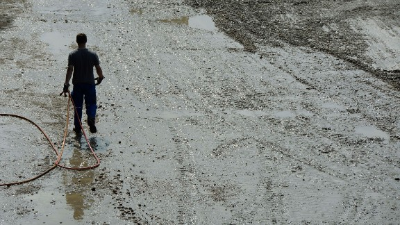 A man walks through the mud in the village of Fischerdorf near Deggendorf, southern Germany, on June 7.