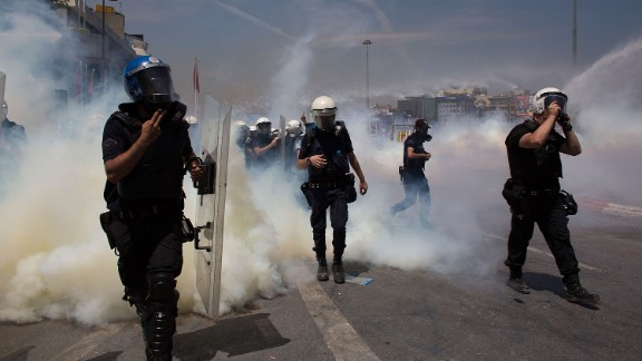 Riot police use water cannons and tear gas to disperse a crowd near Istabul's Taksim Square on June 11.