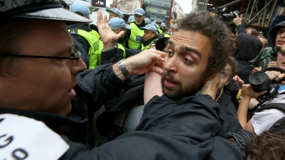 A police officer scuffles with a protester in Soho on June 11.