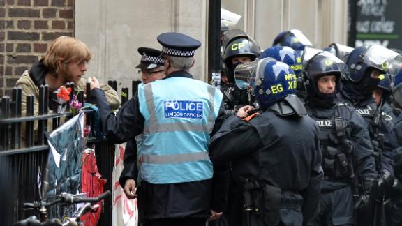 Police speak with a protestor on Beak Street in Soho, central London, on June 11.