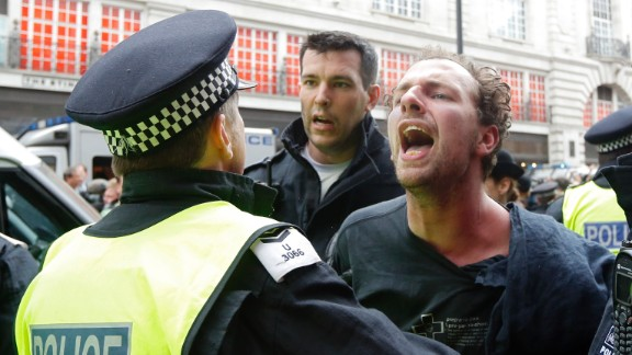 A police officer holds a protester on June 11.