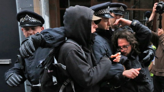Protesters scuffle with police on June 11.