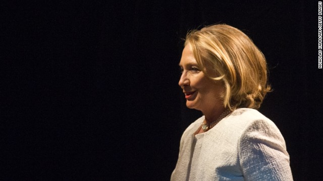 Former US Secretary of State Hillary Clinton arrives on stage to address the Vital Voices Global Awards ceremony at the Kennedy Center in Washington on April 2, 2013. The event honors 'women leaders from around the world who are the unsung heroines to strengthen democracy, increase economic opportunity, and protect human rights,' according to the group's website. AFP PHOTO/Nicholas KAMM (Photo credit should read NICHOLAS KAMM/AFP/Getty Images)