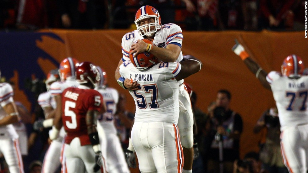 Tebow celebrates with teammate Carl Johnson after throwing a touchdown during the 2009 BCS National Championship game against Oklahoma. The Gators won 24-14.