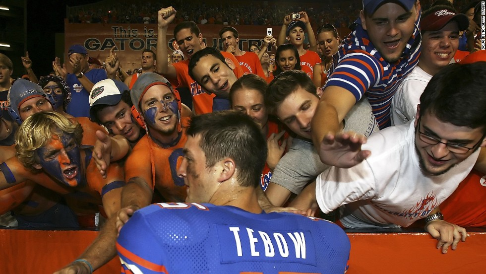 Florida fans greet Tebow after the Gators defeated Southern Mississippi in September 2006. Tebow rushed for a touchdown on the first play of his college career.