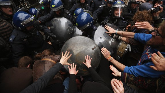 Riot police clash with protesters in London's Golden Square on Tuesday, June 11, during a demonstration ahead of the Group of Eight summit in Northern Ireland.