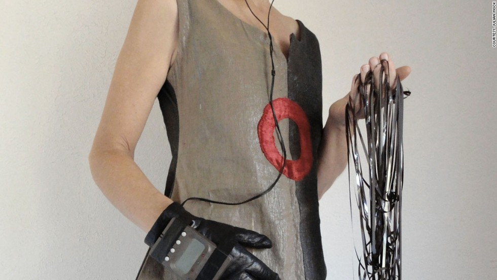 Half beige and half gray, the 'sonic superhero dress' was the first garment Santoro made in 2003. It used 100 individual cassette tapes recorded with a range of sounds -- mix tapes, ocean surf, Laurie Anderson, Beethoven, The Beatles and her high school punk band