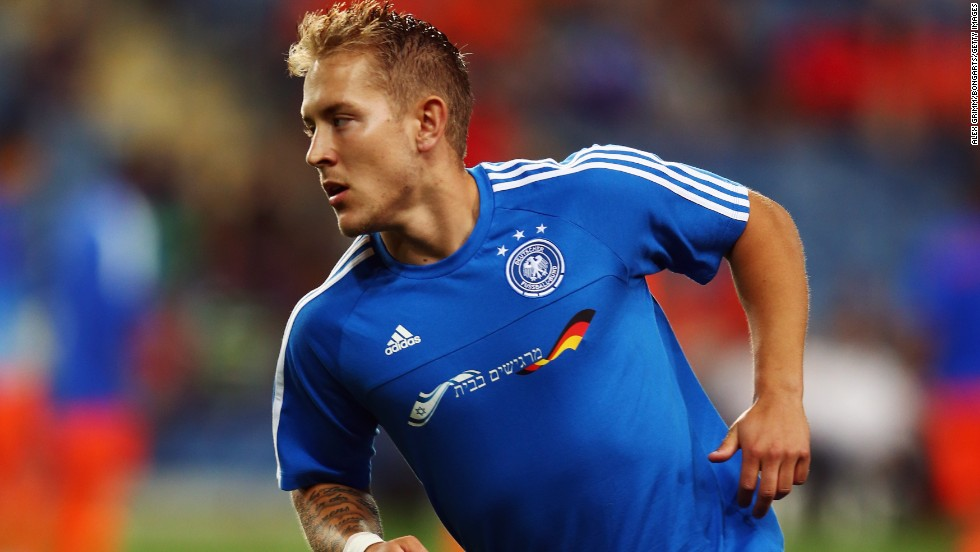 "Germany captain Lewis Holtby wears a specially made training shirt with the Israeli flag and the words ""Feeling at home"" embroidered on the front to thank the host fans for making the team welcome at the European Under-21 Championship."