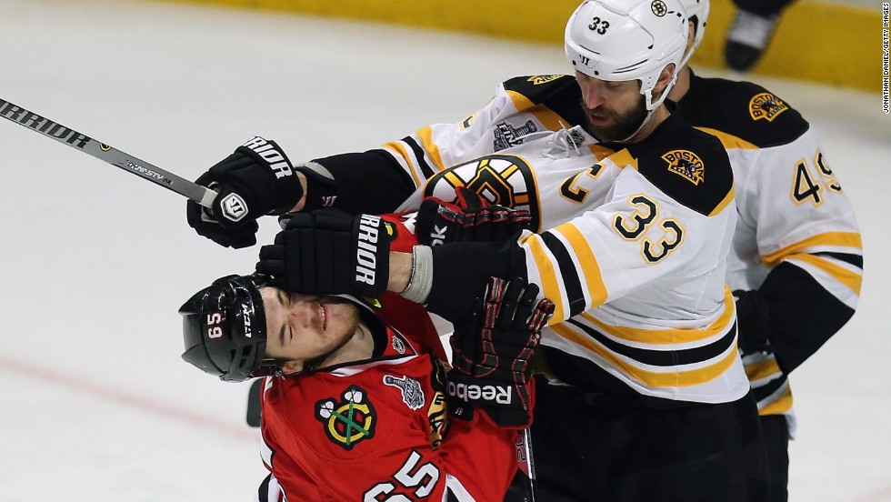 Zdeno Chara of the Boston Bruins, right, pushes Andrew Shaw of the Chicago Blackhawks.