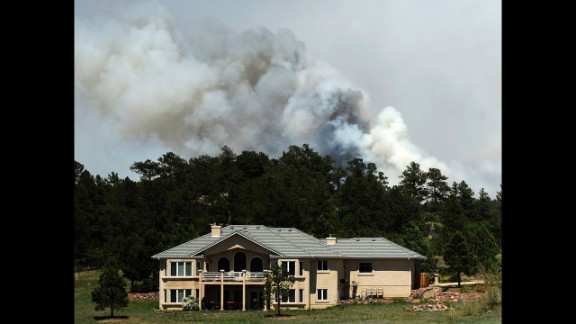 Smoke billows from the Black Forest Fire near a house north of Colorado Springs on June 12.