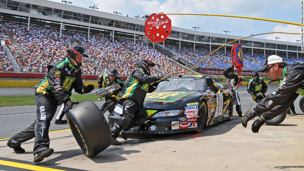 Leffler's pit crew works on his car during the NASCAR Nationwide Series Tech-Net Auto Service 300 at Charlotte Motor Speedway in Concord, North Carolina, on May 29, 2010.