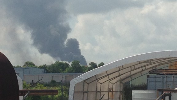The plume of smoke from the explosion can be seen from a great distance.