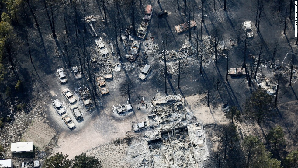An aerial view on June 13 shows destroyed house and vehicles after the Black Forest Fire passed through Black Forest, Colorado.