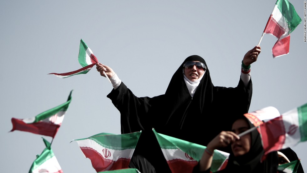 Supporters of top nuclear negotiator and conservative presidential candidate Saeed Jalili wave national flags during his campaign rally at Heydarnia stadium in Tehran on Wednesday, June 12.