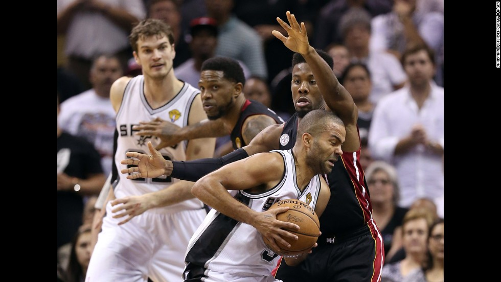 Tony Parker of the San Antonio Spurs drives on Miami's Norris Cole in the second half of the game.