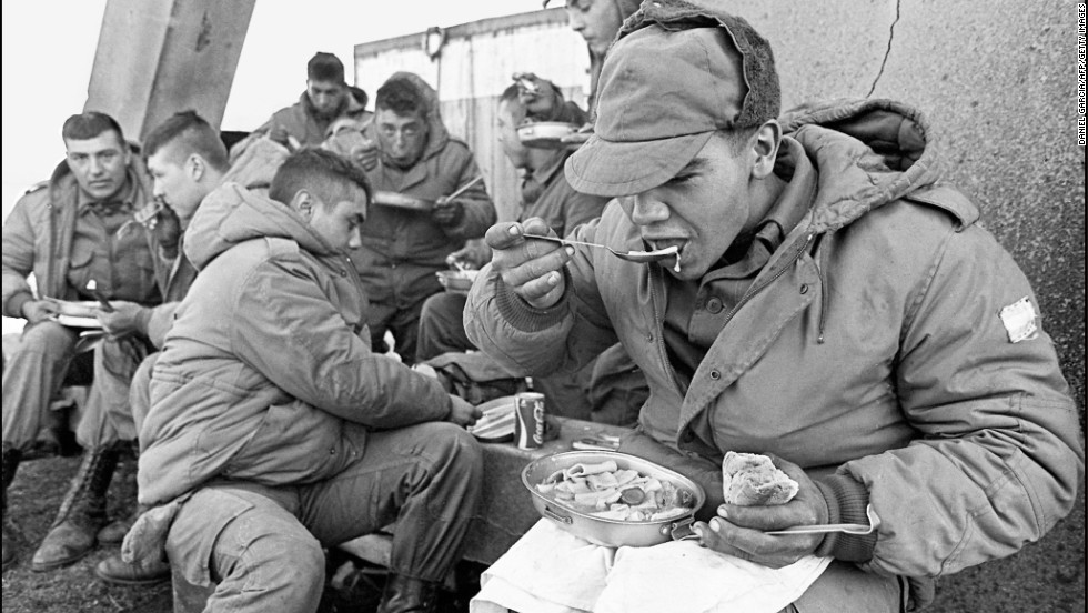 The Gurkha veterans envied the warm clothing and plentiful rations Argentine soldiers, such as these pictured at a partially destroyed former Royal Marines base on April 13, 1982, enjoyed.