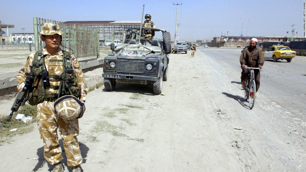 Nepali Gurkha soldiers of the British contingent of the International Security Assistance Force (ISAF) patrol the streets of Kabul, Afghanistan in 2005.