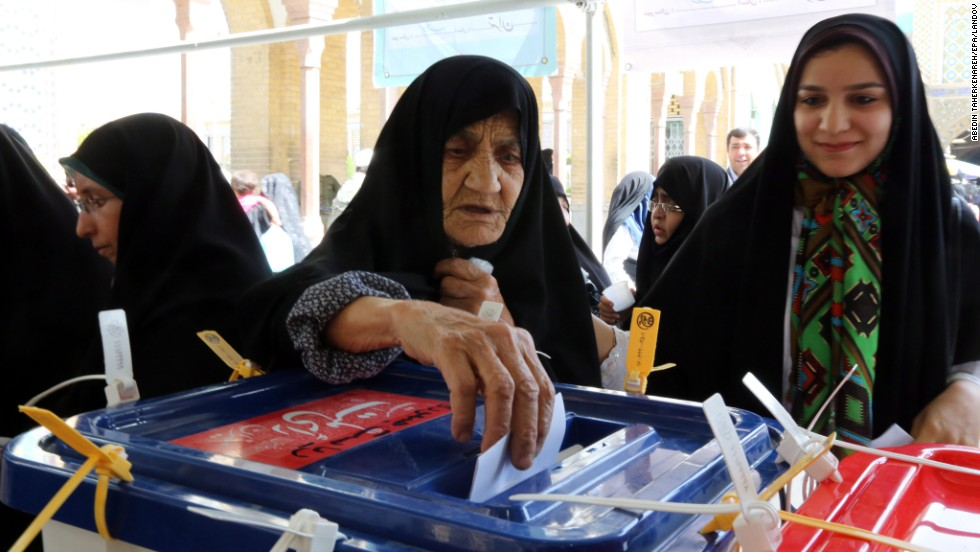A woman casts her ballot during the Iranian presidential elections in Shahr-e-Rey on June 14.