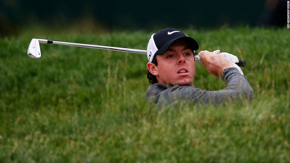 Rory McIlroy of Northern Ireland hits from a bunker on the 15th hole on June 14.