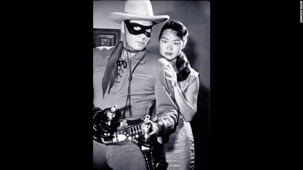 Moore, as the Lone Ranger, protects a lady in distress.