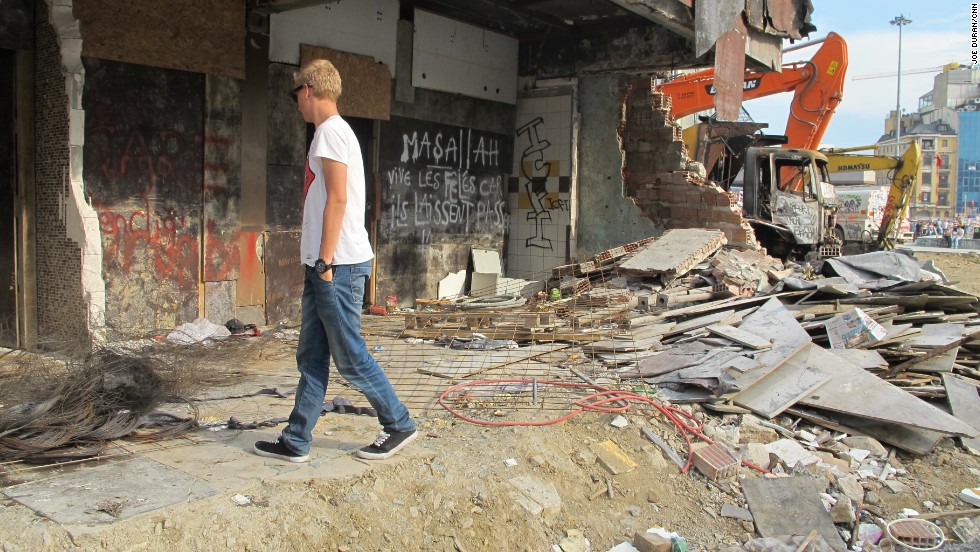 18-year-old holidaymaker Stenver Koop walks amongst building debris after the recent clashes in Istanbul's Taksim Square.
