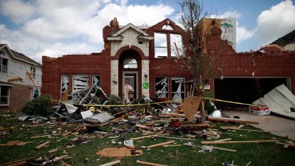 A tornado-damaged home in Forney, Texas, lies in ruin on April 4, 2012. Tornadoes across the greater Dallas-Fort Worth area in early April caused an estimated $1 billion in damage.
