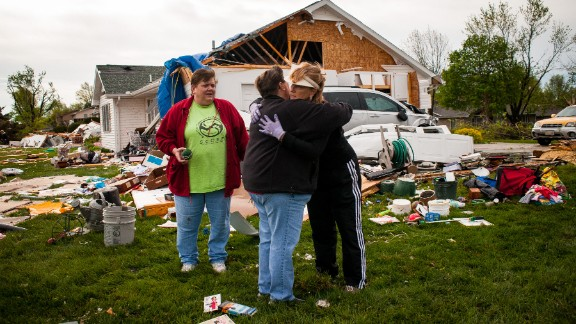 Two women embrace while surveying the damage left in the wake of a tornado that hit Creston, Iowa, on April 15, 2012. An outbreak of tornadoes in the Midwest on April 13 and April 14 caused about $1.1 billion in losses.