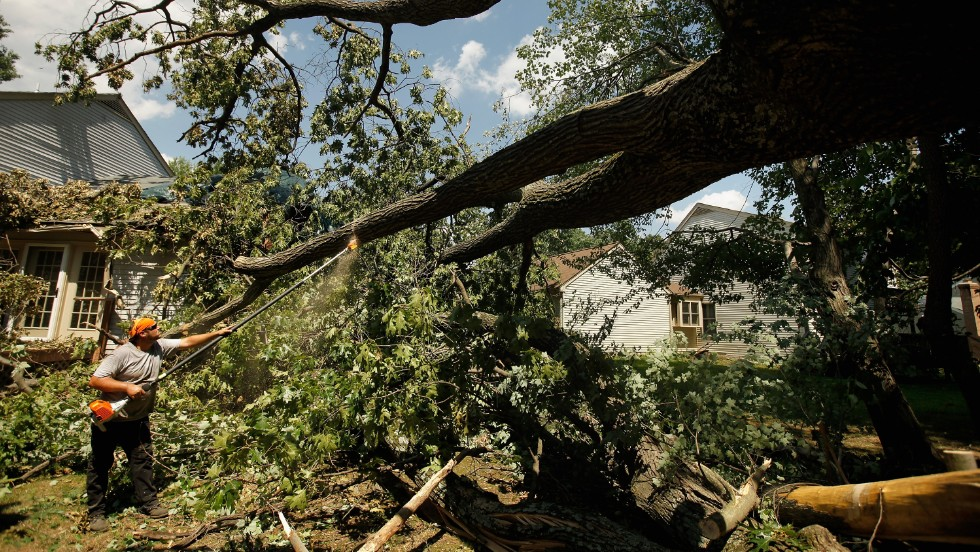 Leveled trees are cleared from an area of Silver Spring, Maryland, on July 2, 2012. An outbreak of thunderstorms and high winds that rolled through Central, Eastern, and Northeastern states June 29 through July 2 last year caused an estimated $2.9 billion in losses.