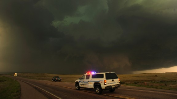 Dark storm clouds producing rain, hail and lightning move east of Calhan, Colorado, on June 7, 2012. Severe storms and damaging hail hit Colorado, New Mexico and Texas in June 2012, causing about $2.6 billion in damage.