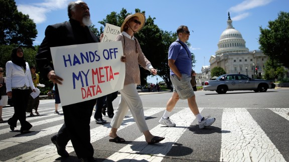 Protesters rally against the NSA's recently detailed surveillance programs June 13, 2013 in Washington, DC.