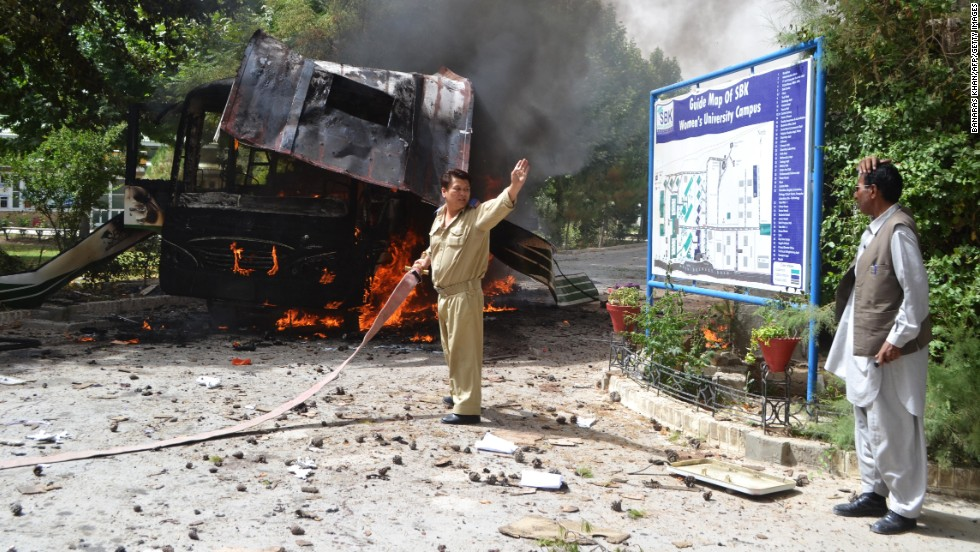 "Firefighters work to extinguish the burning bus. ""All the (bus) victims are women teachers and students,"" according to a police official, Mir Zubair Mehmood, in Quetta."