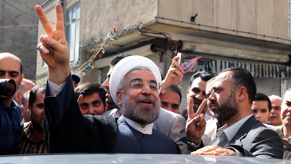 "Rouhani leaves a polling station after voting in Tehran on Friday, June 14. About 50 million Iranian voters were eligible to go to the polls to select a new president from <a href=""http://www.cnn.com/2013/06/04/world/meast/iran-election-candidates-profile/index.html"">a field of six candidates</a>."