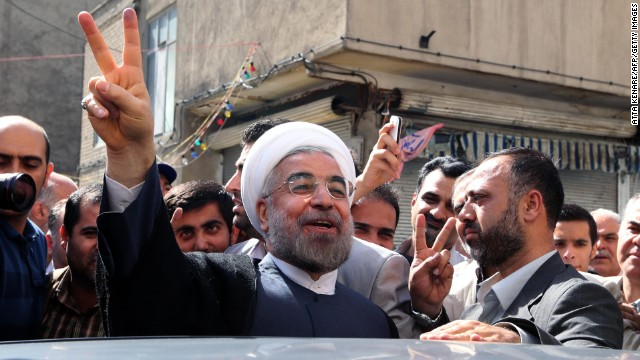 Presidential candidate Hassan Rouhani leaves a polling station after voting in Tehran, on Friday, June 14.