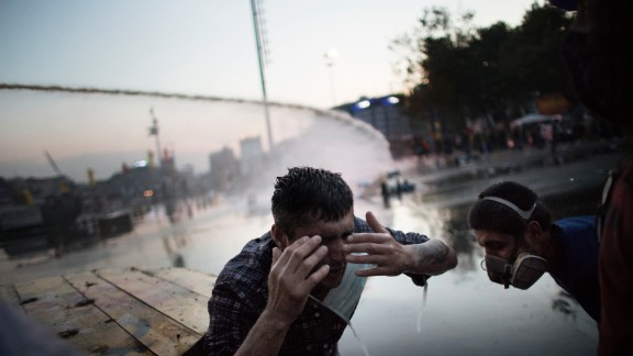 A protester on June 15, reacts in pain to a salvo of tear gas fired by Turkish riot police chasing out demonstrators in order to dismantle their tent camp in Gezi Park in Istanbul.