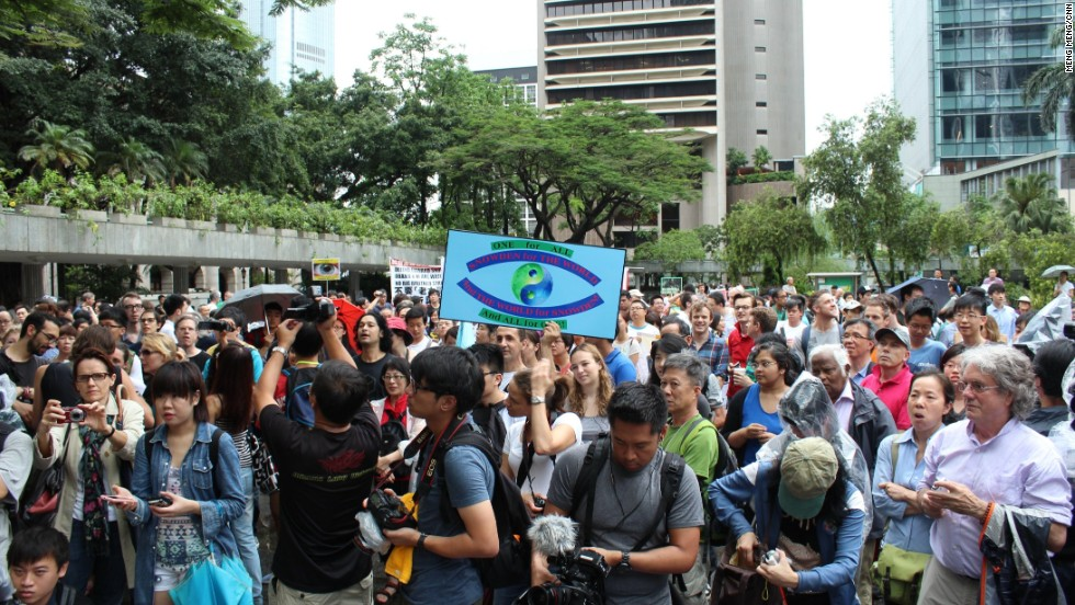 Protesters and media gathered in Chater Garden in the city's business district to kick off the three-hour protest.