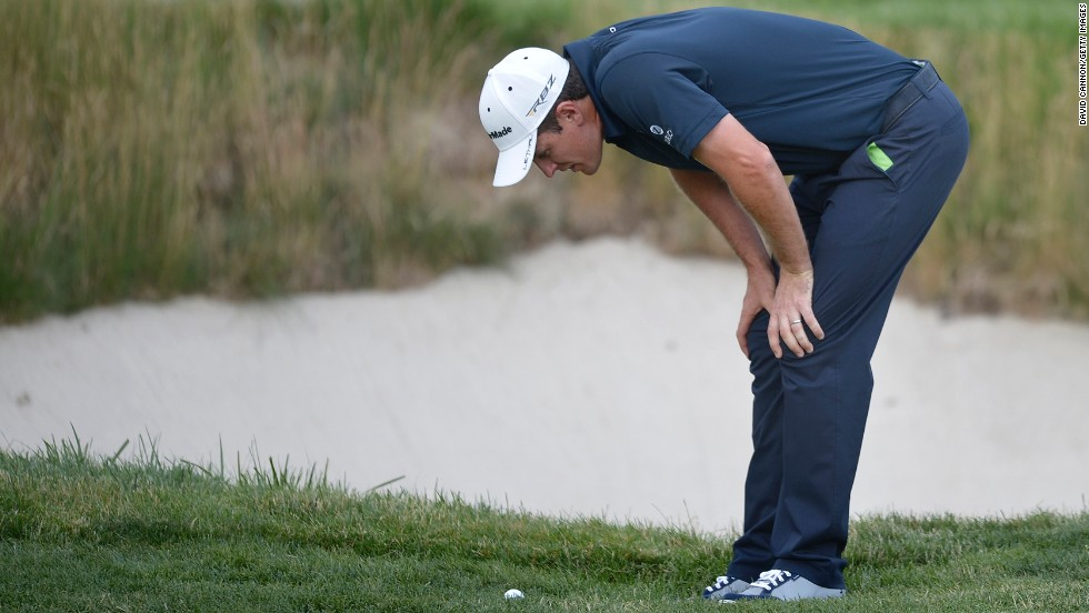 Justin Rose plans the next shot near the 17th green on June 15.