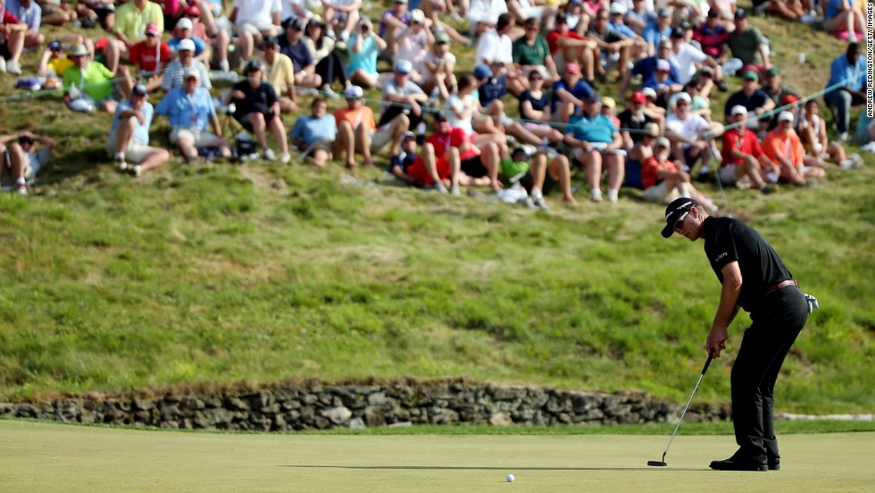 John Senden of Australia putts on the ninth hole on June 15.
