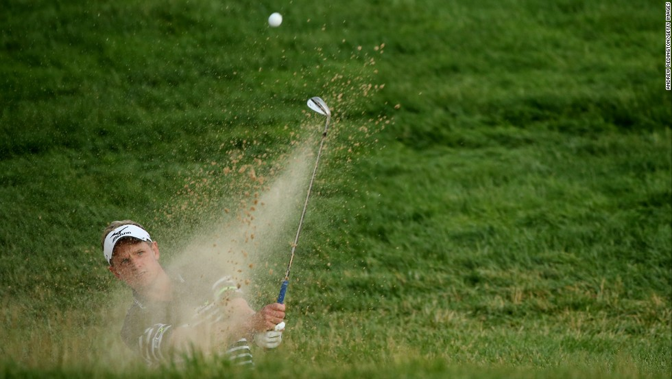 Luke Donald hits a shot from a bunker on the 17th hole during round three on June 15.