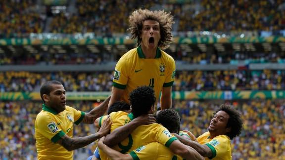 David Luiz, center, led the celebrations after Neymar's opener for Brazil against Japan.