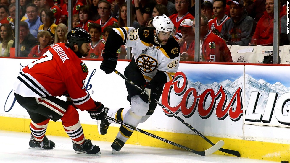 Brent Seabrook of the Chicago Blackhawks battles against Jaromir Jagr of the Boston Bruins for the puck.