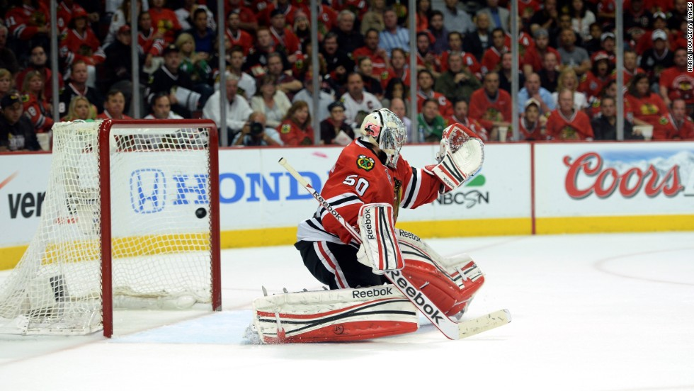 Goalie Corey Crawford of the Chicago Blackhawks lets in the game-winning goal during the first overtime. Daniel Paille of the Boston Bruins made the score.