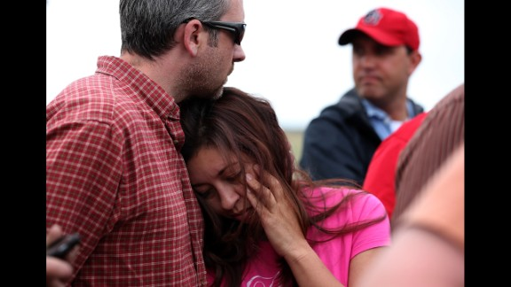Bonnie Kruse hugs her husband, James Kruse, at a press conference in Colorado Springs on June 14.